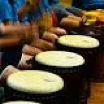 children hands on djembes