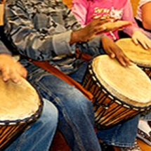 hands on line of djembes